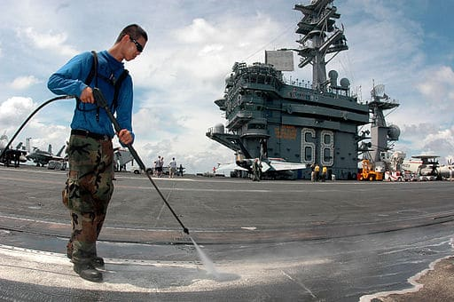 Using a pressure washer aboard a US Navy war ship. Big btasks need big tools!
